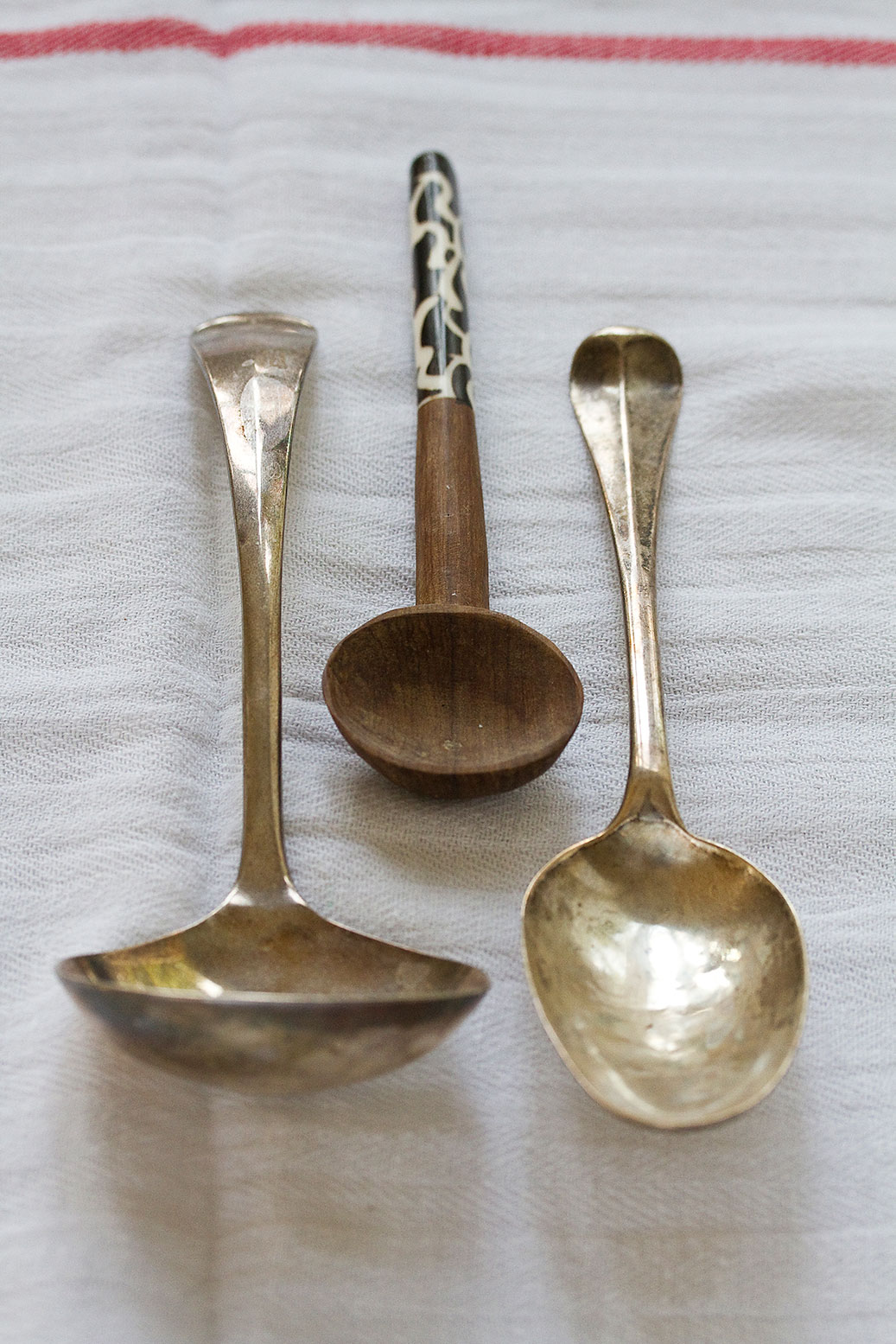 Three spoons on a cloth